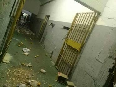 Food thrown back into hallway after prisoners refuse to eat.