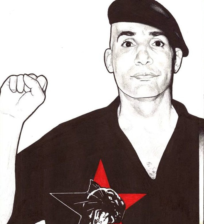 Comrade Malik with fist raised, panther logo